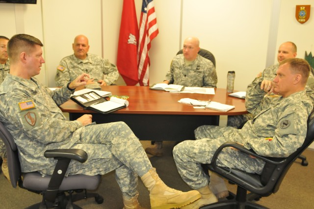 Maj. Gen. Tracy Thompson (left), commanding general, 412th Theater Engineer Command, and Col. Spencer, director, ACSENG, US Army Pacific, discuss engineering requirements and support during an office call Aug. 26, 2014 at Fort Shafter, Hawaii.  As the Army Reserve's theater engineer in the Pacific, the 412th deployed approximately 80 Soldiers to Korea, Japan and Hawaii to provide engineering expertise and other support functions during UFG and in support of mission requirements for Eighth Army, U.S. Forces Korea and U.S. Army Pacific.