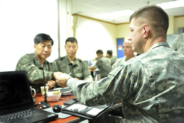 Maj. Gen. Tracy Thompson, commanding general, 412th Theater Engineer Command, exchange information with Brig. Gen. Joung Youn Kim, Assistant Chief of Staff/ Combined Forces Engineer, Combined Forces Command, during an office call at Ulchi Freedom Guardian Exercise, Aug. 18, 2014 in the Republic of Korea.  As the Army Reserve's theater engineer in the Pacific, the 412th deployed approximately 80 Soldiers to Korea, Japan and Hawaii to provide engineering expertise and other support functions during UFG and in support of mission requirements for Eighth Army, U.S. Forces Korea and U.S. Army Pacific.
