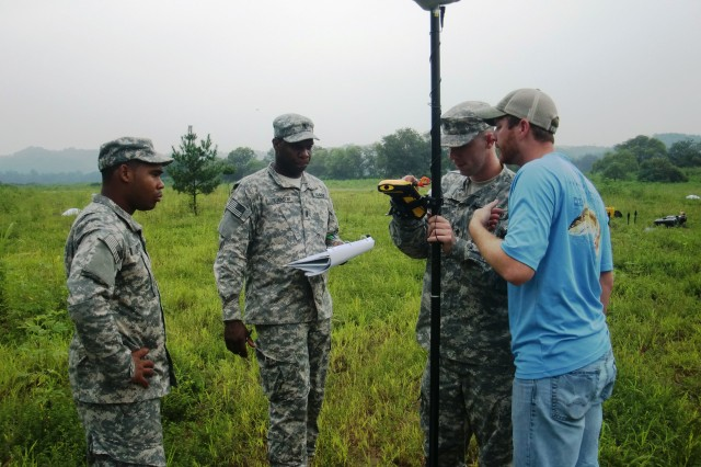 YONGSAN, Republic of Korea - Pvt. Quashaud Brown, 1st Lt. Brian Stevenson, and Spc. Zachary Gawthorp, of 368th Engineer Detachment (Forward Engineer Support Team-Main), and Kenneth McLaughlin use a GPS to get precise coordinates of a system component during Ulchi Freedom Guardian Exercise 2014, Aug. 18-29, 2014.
