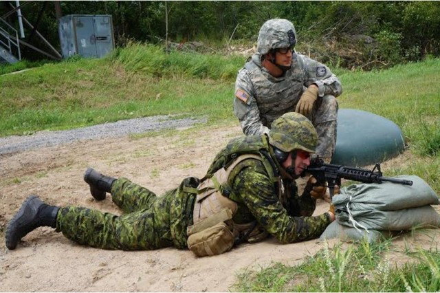 The Canadian Soldiers were qualified for record to the same standards as their U.S. Army counterparts.  Photo courtesy of SGT Alexandra Kennedy, 23D Military Police Company.