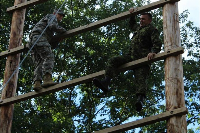 Soldiers tackled Fort Drum Air Assault Obstacle Course Obstacles. Photo courtesy of 2LT Bergen E. Nelson, Asst. S-2 / PAO 91ST Military Police Battalion.