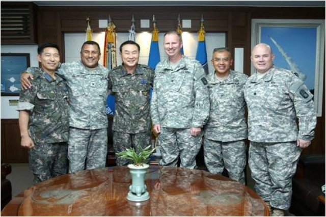 COL. Robert W. Lyons, deputy commander, 94th Army Air and Missile Defense Commmand and COL. Carlos J. Betancourt, assistant chief of staff (operations), 94th AAMDC, pose for a photo with Republic of Korea counterparts during exercise Ulchi Freedom Guardian 2014. UFG is the largest computerized command-and-control exercise in the Asia-Pacific. (U.S. Army photo)