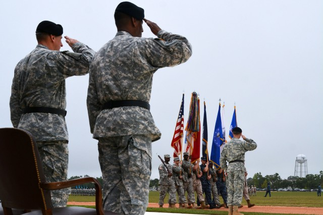 Maj. Gen. Stephen G. Fogarty, incoming commanding general of U.S. Army Cyber Center of Excellence and Fort Gordon, salutes during the pass and review during the Cyber CoE change-of-command ceremony Monday at Barton Field. Outgoing Commanding General Maj. Gen. LaWarren V. Patterson and Lt. Gen. Robert B. Brown, commanding general U.S. Army Combined Arms Center and Fort Leavenworth, Kansas, overlook the procession and return salutes.