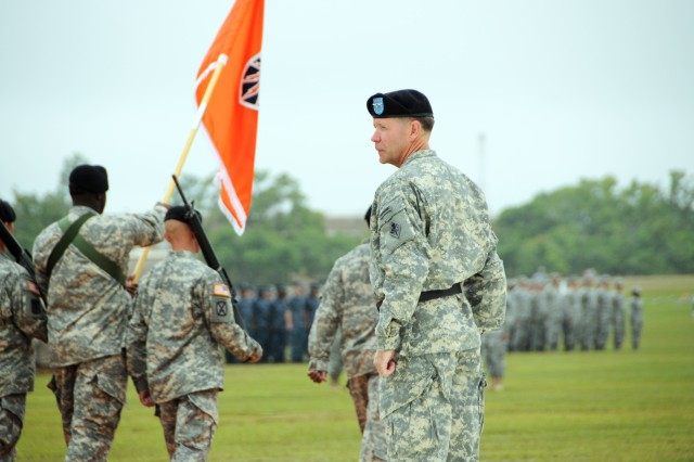 Cyber Center of Excellence and Fort Gordon Commanding General Maj. Gen. Stephen G. Fogarty conducts a pass and review during a change of command Monday at Barton Field.