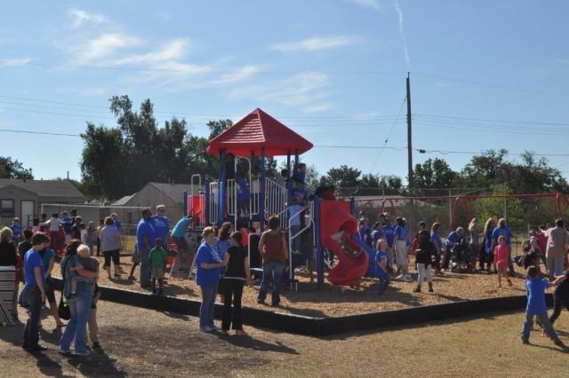 Student and Teacher alike enjoy the new playground at Swinney Elementarty School.