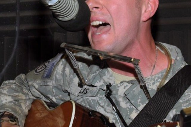 Staff Sgt. Jeffrey Ellis, a drill sergeant with 1/320th Inf. (BCT), 98th Training Division (IET), United States Army Reserve, performs live on the radio at AFN Iraq during his 2010 deployment in support of Operation New Dawn. Ellis, a talented musician, has won multiple awards for his singing-songwriting and travels the east coast playing in various venues.