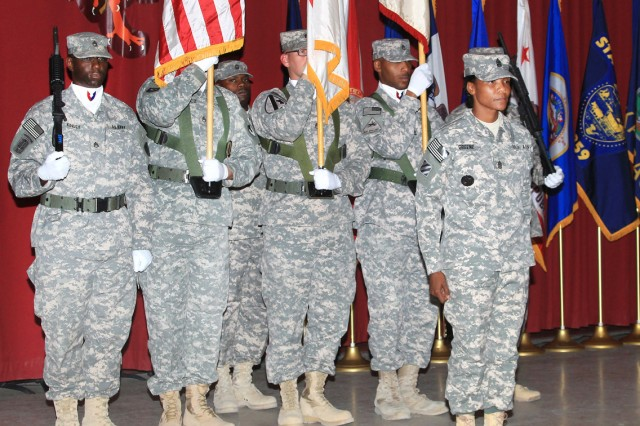 Command Sgt. Maj. Cheryl N. M. Greene, incoming command sergeant major, 402nd AFSB, stands in front of the 402nd AFSB color guard as the assumption of responsibility ceremony concludes July 30, at Camp Arifjan, Kuwait. (U.S. Army Photograph)