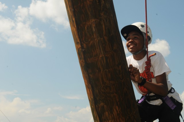 """Caleb Strother, son of Sgt. 1st. Class Woodson Strother, 94th Training Division, 80th Training Command (TASS) climbs the 50 foot hourglass shaped Alpine Tower at George Mason University, Fairfax, Va. Sept. 6, 2014. Strother celebrated his 15th birthday on the same day. He and four other teenagers from across the command climbed the tower as part of a confidence building exercise when they participated in the Family Readiness Program inaugural Teen Council meeting which took place in Sterling, Va., Sept. 5-7.""""If I was home I'd probably just hang out, play Xbox, and maybe go out for dinner, but being here getting to know these new people is really fun,"""" Strother said."""