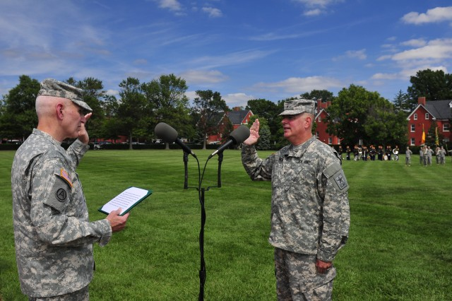 Lieutenant General William T. Grisoli, left, the director of the U.S. Army Staff, swears in Brigadier General Mark S. Inch as the 15th Provost Marshal General of the U.S. Army during a formal ceremony Sept. 12, 2014, at Joint Base Myer-Henderson Hall's Summerall Parade Field.