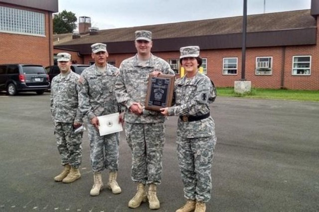 Chief Warrant Officer 2 Mark Bowling (center right), 377th Engineer Company, construction engineering technician, from Portersville, Pa., received the Army Engineer Association Best Warrant Officer Award, Sept. 6 during a ceremony in Butler, Pennsylvania. The award was presented by Chief Warrant Officer 5 Carlos Jimenez (center left), 412th Theater Engineer Command, command chief warrant officer and Brig. Gen. Miyako Schanely (right), deputy commanding general, 412th TEC.