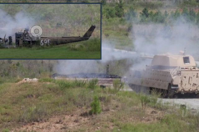 A Bradley Fighting Vehicle mounted with an XM813 30-mm weapon system fires rounds and hits a downed helicopter from more than 1,000 meters away during a demonstration for the XM813 Sept. 10 at Fort Benning's Digital Multi-Purpose Range Complex.