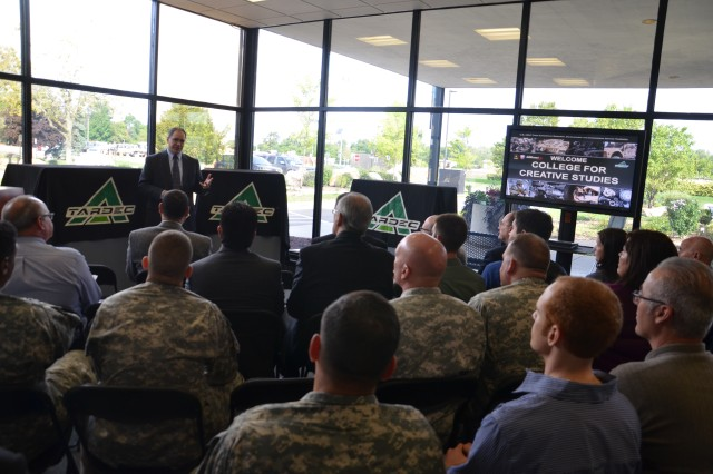 TARDEC Director, Dr. Paul Rogers explains the many benefits of the Soldier Innovation Workshops before the 3D models are unveiled.