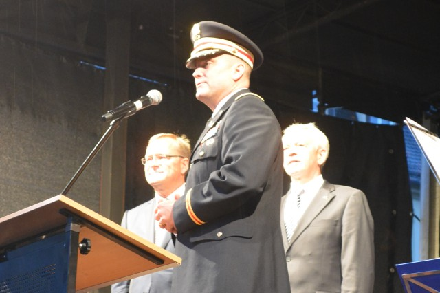 Col. Christopher M. Benson, U.S. Army Garrison Ansbach commander, addresses a crowd at a fest hosted by the city of Bamberg following the USAG Bamberg closure ceremony. After nearly 70 years of American Soldiers in Bamberg, Germany, the U.S. Army Garrison Bamberg colors were cased and the American flag was lowered for the final time Sept. 12, 2014.
