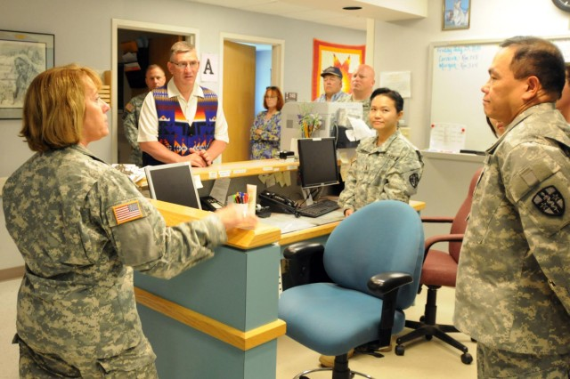 Lt. Col. Janice Van Alstine (left), of the 4225th U.S. Army Hospital, and Army Reserve Soldiers of the West Medical Area Readiness Support Group, discuss their Innovative Readiness Training at the Fort Belknap, Mont., medical facility with Montana Sen. John Walsh, July 27, 2014. The Innovative Readiness Training program allows reserve-component units to hone their wartime readiness through hands-on training while simultaneously providing quality services to communities throughout the U.S.