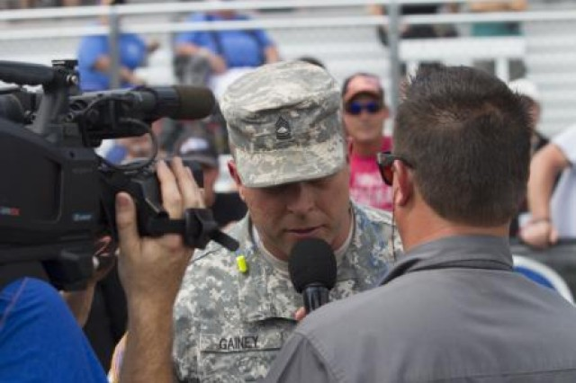 Master Sgt. Michael Gainey, 108th Training Command (IET), U.S. Army Reserve, gives a track-side interview at the seventh annual Pep Boys NHRA Carolina Nationals held at the zMax Dragway in Concord, N.C. Gainey was invited to speak as a Soldier Hero at the event and has a Bronze Star with Valor and Purple Heart for his service during Operation Iraqi Freedom.
