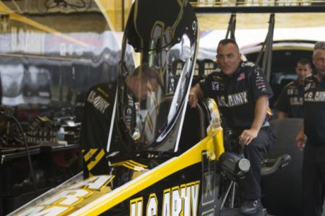 "Tony ""the Sarge"" Schumacher prepares to fire up his U.S. Army Top Fuel Dragster before the Nitro Qualifying Round 3 at the Pep Boys NHRA Carolina Nationals. Schumacher drives the U.S. Army Top Fuel Dragster and has a record seven overall NHRA Top Fuel series championships."