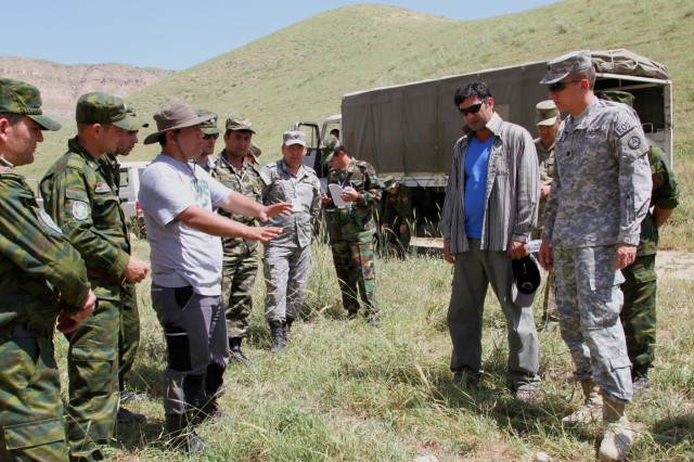 Lt. Col. Benjamin Lipari (right), the U.S. Army Central Command Explosive Ordnance Disposal chief, attends the first International Mine Action Standard EOD level-one course in Tajikistan, in June 2014.  U.S. Army EOD Soldiers have returned to Tajikistan in September for a Humanitarian Mine Action training mission.