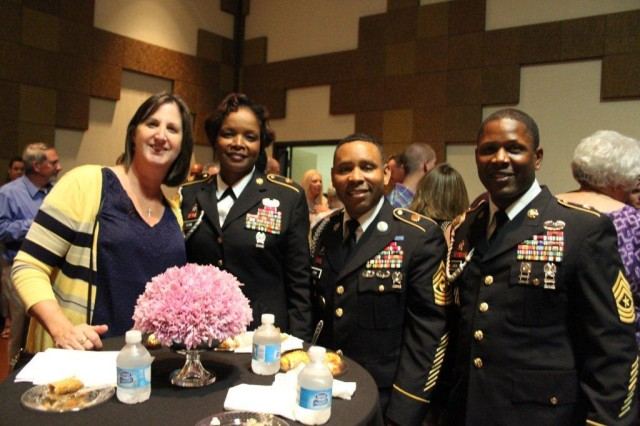 Garrison Command Sgt. Maj. Kyle Crump, third from left, enjoys the camaraderie of fellow Soldiers and Soldier families at a reception before the Soldier Show during Armed Forces Celebration Week in July. With him, from left, are Debby Hoskin, wife of Brig. Gen. Michael Hoskin, commander of the Expeditionary Contracting Command; ECC Command Sgt. Maj. Angel Clark; and Sgt. Maj. Franklin Jordan, inspector general of the Army Materiel Command.