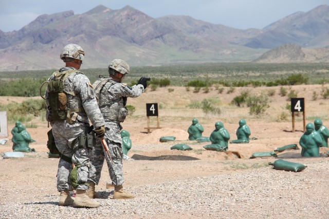 Soldiers assigned to California National Guard's 670th Military Police Company attempt to qualify on Berretta 9mm pistols at McGregor Range, N.M., recently in preparation for a deployment to Guantanamo Bay Naval Base, Cuba. (Photo by Maj. Amabilia Payen, 5th Armored Brigade, Division West Public Affairs)