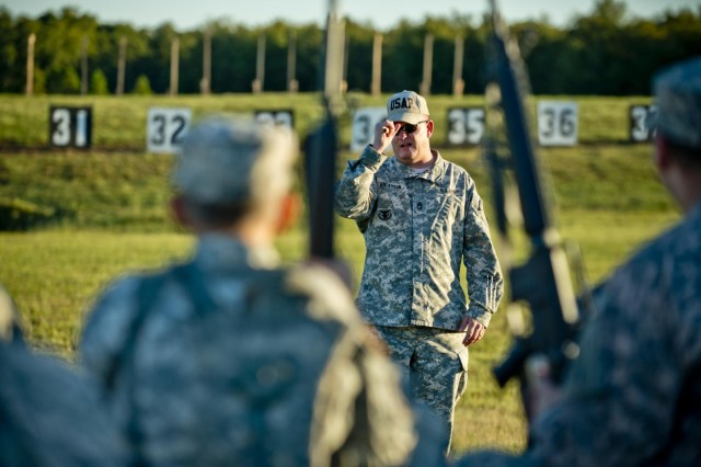Master Sgt. Norman Anderson, head coach of the Army Reserve Rifle Team, of Knoxville, Tenn., teaches a rifle marksmanship refresher course to a group of competitors, Sept. 22, 2014, before the start of the inaugural Army Reserve Small Arms Championship hosted at Camp Robinson, Ark. Approximately 70 Soldiers, comprising 14 teams, came from all over the country to compete.