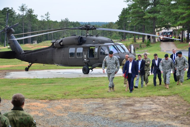 Maj. Gen. Eric Wendt, Commanding General for U.S. Army John F. Kennnedy Special Warefare Center and School (SWCS) greeting Polish Head of State, President Bronislaw Komorowski with U.S. Army Special Operations Command Commanding General Lt. Gen. Charles T. Cleveland (right) during his visit to Fort Bragg, N.C. 23 Sept. The intent of the visit was to witness the culmination event of a capabilities exercise between the combined Special Operations Forces and further enhance his knowledge of the Special Operations Command infrastructure.