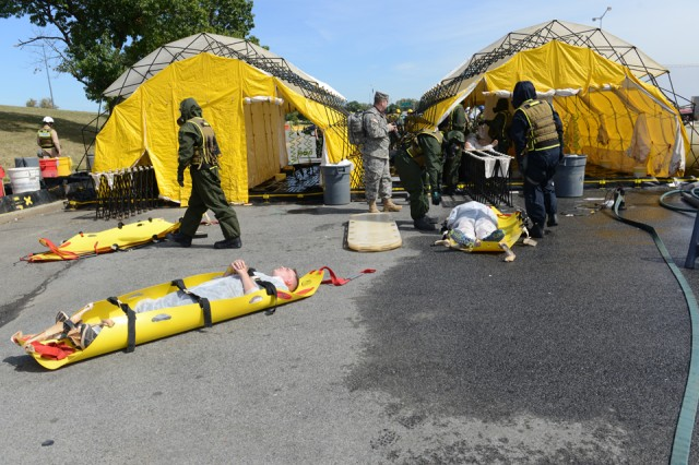 Mock victims wait to go through the decontamination line during the Capital Shield 2015 exercise, in which local and federal emergency staged a response to a chemical attack scenario, Washington, D.C., Sept. 23, 2014.