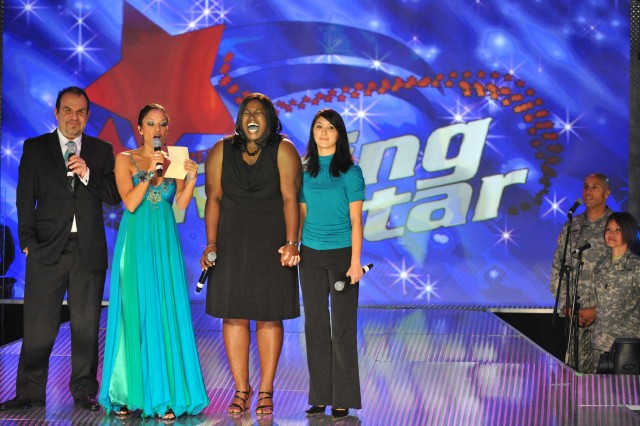 "Left to right, co-host Victor Hurtado, host GeNienne Samuels, winner Joyce Dodson and runner-up Fatima McElveen react when Samuels announces Dodson as the winner of the 2008 Operation Rising Star military singing contest, at Wallace Theater on Fort Belvoir, Va. Dodson will return to the home of Army Entertainment on Joint Base San Antonio-Fort Sam Houston, Texas, in December as an ""All-Star,"" to help mentor and perform alongside one of six finalists in the 2014 Operation Rising Star event. Hurtado, an Army Entertainment alum, will be there to work with his protegees, and Samuels will host the event for the seventh time."