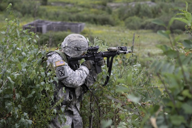 A Soldier assigned to A Troop, 1st Squadron, 89th Cavalry Regiment, 2nd Brigade Combat Team, suppresses the enemy during a platoon-level live-fire validation course Sept. 8-19 on Fort Drum's training areas. Soldiers fell back to their Humvees where they suppressed the enemy's advance with automatic weapons fire.