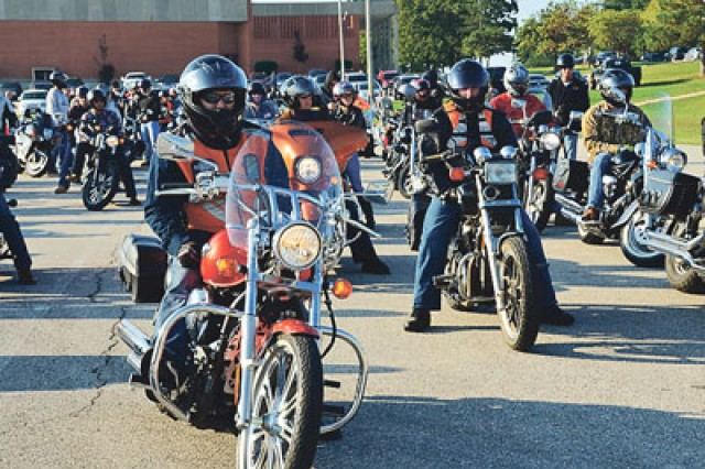 Motorcyclists depart from the Baker Theater parking lot for the Post Motorcycle Mentorship Ride.