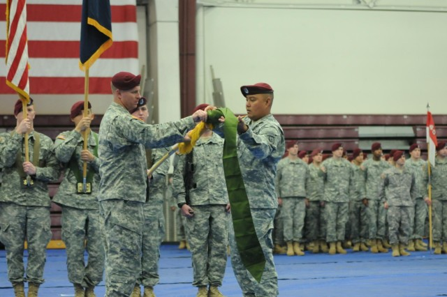 Lt. Col.  Mark D. Federovich (left), the commander of the 1st Squadron (Airborne), 40th Cavalry Regiment, 4th Infantry Brigade Combat Team (Airborne), 25th Infantry Division, and Command Sgt. Maj. Jan C. Araneta (right), the senior enlisted advisor of Denali Squadron, case the unit's colors during the squadron's deployment ceremony September 19, 2014 at Joint Base Elmendorf-Richardson, Alaska. (U.S. Army photo by Sgt. 1st Class Jeffrey Smith/Released)