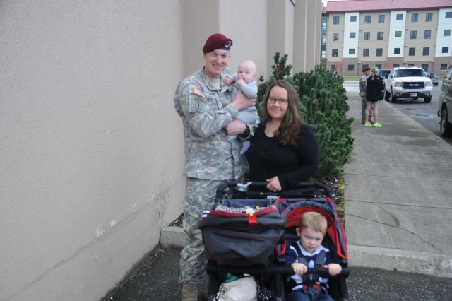 A paratrooper with the 1st Squadron (Airborne), 40th Cavalry Regiment, 4th Infantry Brigade Combat Team (Airborne), 25th Infantry Division takes a moment for a photo with his Family following the Danali Squadron's deployment ceremony Sept. 19, 2014 at Joint Base Elmendorf-Richardson, Alaska. (U.S. Army photo by Sgt. Brian Ragin/Released)