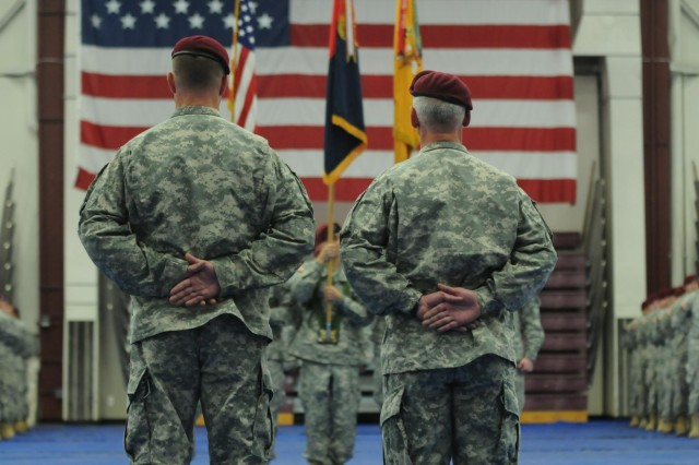 Lt. Col.  Mark D. Federovich (left), the commander of the 1st Squadron (Airborne), 40th Cavalry Regiment, 4th Infantry Brigade Combat Team (Airborne), 25th Infantry Division, and Lt. Col. Clinton J. Baker, commanding officer of Multinational Battle Group-East, Kosovo Force, stand at Parade Rest in front of the Color Guard during the Denali Squadron's deployment ceremony Sept. 19, 2014 at Joint Base Elmendorf-Richardson, Alaska. (U.S. Army photo by Sgt. 1st Class Jeffrey Smith/Released)