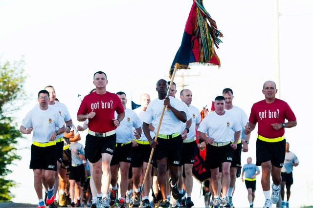 Maj. Gen. Paul E. Funk II, 1st Infantry Division and Fort Riley, Kansas, commanding general, (red shirt on left) leads a formation of Big Red One Soldiers during the division's 96th birthday Victory Run, June 10, 2013. Next month, he leads his headquarters to Iraq.