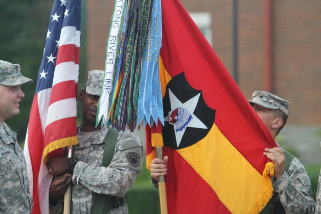 A color guard detail takes care of the 2nd Infantry Division Artillery flag, following its uncasing during a ceremony to activate the unit Sept. 25 at Joint Base Lewis-McChord.