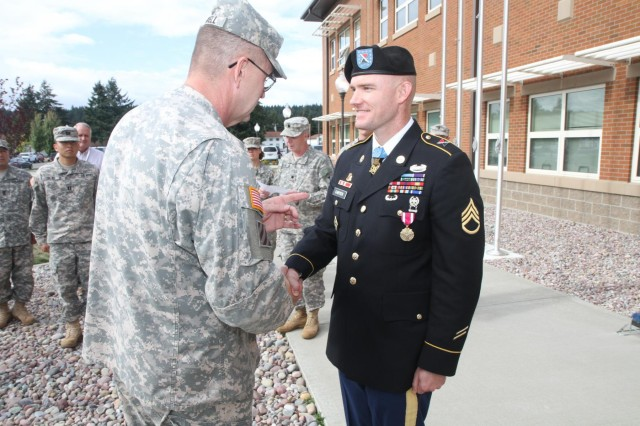 Medal of Honor recipient Staff Sgt. Ty Carter (right) receives a Meritorious Service Medal from Maj. Gen. Terry Ferrell, commander, 7th Infantry Division, during a ceremony, Sept. 26, 2014, at Joint Base Lewis-McChord, Wash.