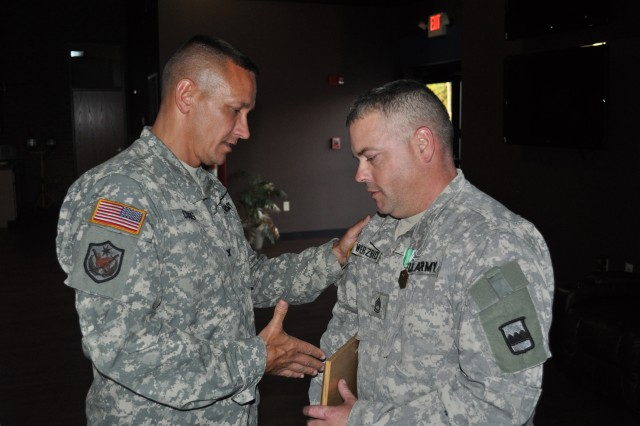 "Col. Clarence Combs, 80th Training Command deputy operations officer, congratulates Sgt. 1st Class Kevin Wierzbick, A Co, 3/399th Logistical Support Brigade after Combs awarded the Army Commendation Medal to Wierzbick who received top honors in the mechanic category of the 800th LSB's Logistical Training Exercise, also known as a ""Truck Rodeo,"" at Fort Knox Ky., Sept. 20, 2014. The LTX assesses the competence level of Army truck drivers and wheeled vehicle mechanics regarding their primary missions of providing transportation and maintenance services."