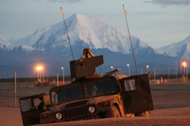 A Military Police Soldier from A Co, MP, 49th Missile Defense Battalion (Ground-based Midcourse Defense) observes movement during a force protection exercise at Fort Greely, Alaska (circa 2007). MPs from A Co, 49th, like their missile defense counterparts, have executed their Title 10 operational security mission 24/7/365 for the past decade in some of the harshest weather in the world. (US Army photo by Staff Sgt. Jack Carlson)