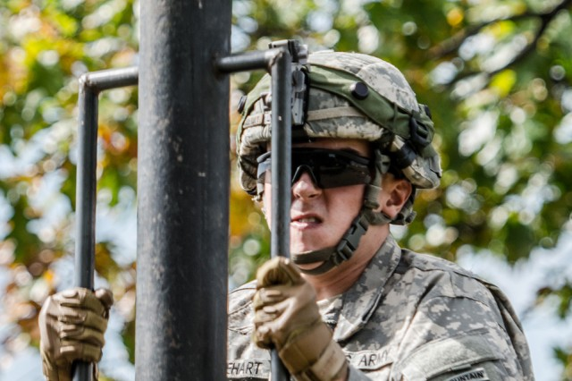 Pfc. Dakota Gabehart, a rifleman with C Company, 1st Battalion, 87th Infantry Regiment, 1st Brigade Combat Team, pounds a stake into the ground Monday to establish the security perimeter for 1st BCT's Tactical Operation Center during the Mountain Peak exercise at Fort Drum.