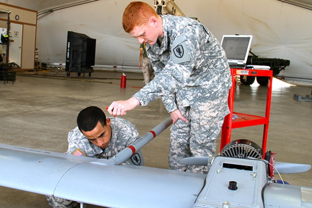 Pvt. Kenneth Lewis and Pvt. Austin Morrison assemble a Shadow Unmanned Aircraft System during training at 2-13th Aviation Regiment, 1st Aviation Brigade, based at Fort Huachuca, Arizona, in July.