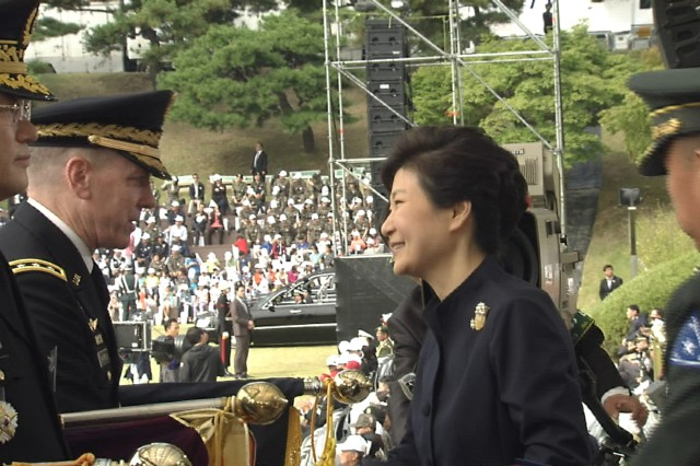 RoK President Park Geun-hye presents the RoK Presidential Unit Citation award to Eighth Army Commander Lt. Gen. Bernard S. Champoux during the opening ceremony of the RoK Ground Forces Festival at RoK Army Headquarters in Gyeryong, South Korea Oct 1.