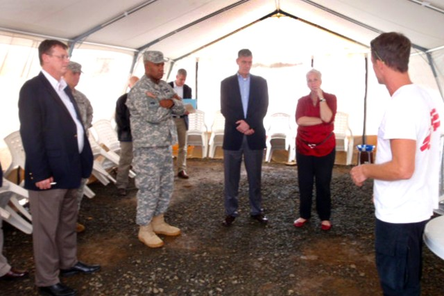 A health worker (far right) from Doctors without Borders briefs (starting second from left) Maj. Gen. Darryl A. Williams, commander of U.S. Army Africa; Gen. David M. Rodriguez, commander of U.S. Africa; and U.S. Ambassador to Liberia, Deborah R. Malac, on the operation of Ebola treatment units. U.S. Africa Command is supporting the effort by providing command and control, logistics, training and engineering assets to contain the Ebola virus outbreak in West African nations.