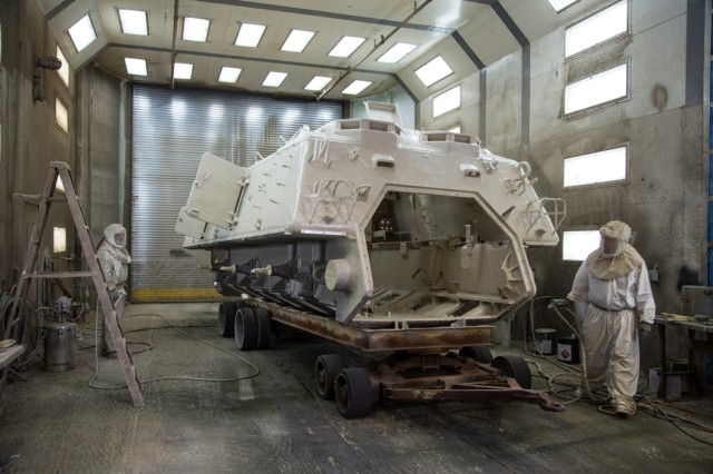 A disassembled M88A1 recovery vehicle is painted at Anniston Army Depot, where 10 vehicles are being refurbished to their original condition before shipment to the Jordan armed forces.