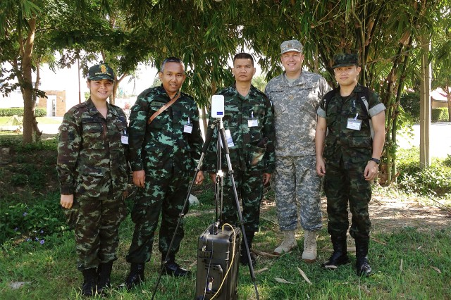 Royal Thai Army and U.S. Army personnel participate in Operation Crimson Viper 2014 at Chao Samran, Thailand, Sept. 23, 2014. (From left) Capt. Kantima Niweswan, Royal Thai Army Chemical Department; Special Master Sgt. 1st Class Aumnart Surthong, RTA Signal Department; Capt. Samart Preeklang, RTA Medical Department; Maj. Scott Christensen, U.S. Army Reserve Sustainment Command, Detachment 8, supporting RDECOM; Sub Lt. Tasapol Ngamtuan, RTA Military Research and Development Center.