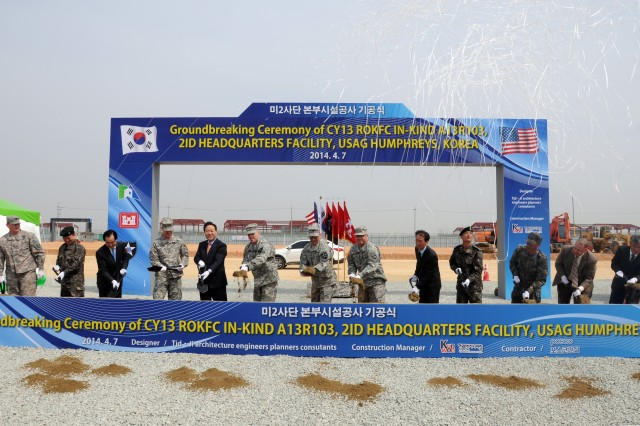 The 2nd Infantry Division Command Team, Maj. Gen. Thomas Vandal and Command Sgt. Maj. Andrew Spano break ground for the new 2nd Inf. Div. Headquarters Building during ceremony held at United States Army Garrison Humphreys in Pyeongtaek, South Korea, April 7, 2014.