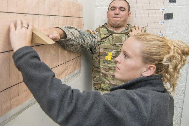 Rachel Terveer measures a Soldier's forward reach extension as part of a study at the Natick Soldier Research, Development and Engineering Center that seeks to understand the link between body armor fit and Soldier performance.