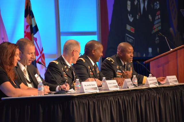 BALTIMORE, MD (Oct. 8, 2014) -- Aberdeen Proving Ground Senior Commander and Commanding General of U.S. Army Communications-Electronics Command Maj. Gen. Bruce T. Crawford (right), led a five-person plenary panel during the Military Communications Conference (MILCOM) at the Baltimore Convention Center with the topic of 'Fielding the Army Tactical Network.' Crawford was joined (from right) by Col. Mark Elliot, Director of the Army's LandWarNet Mission Command; Col. Paul Fredenburg, representing Army CIO/G6; Dr. Paul Zablocky (SES), Director of Space and Terrestrial for U.S Army Communications-Electronics Research, Development and Engineering Center (CERDEC); and Ms. Jennifer Zbozny, Director, Technical Management Division Program Executive Office for Command, Control and Communications-Tactical (PEO-C3T).