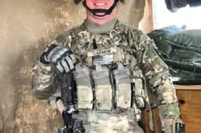 Then Spc. Corey Garmon is shown on active duty before the IED explosion that caused him to lose both his legs below the knee, permanently damaged his left arm, hand and eye, and caused minor traumatic brain injury and post traumatic stress disorder.