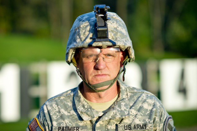 Lt. Col. John Cletus Paumier is an orthopedic surgeon, officer in charge of the Army Reserve Marksmanship Program and command surgeon to the 416th Theater Engineer Command, headquartered in Darien, Ill.