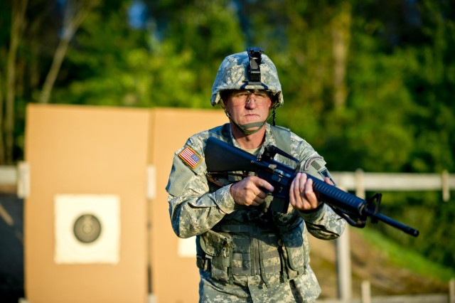 Lt. Col. John Cletus Paumier is an orthopedic surgeon, officer-in-charge of the Army Reserve Marksmanship Program and command surgeon to the 416th Theater Engineer Command, headquartered in Darien, Ill.
