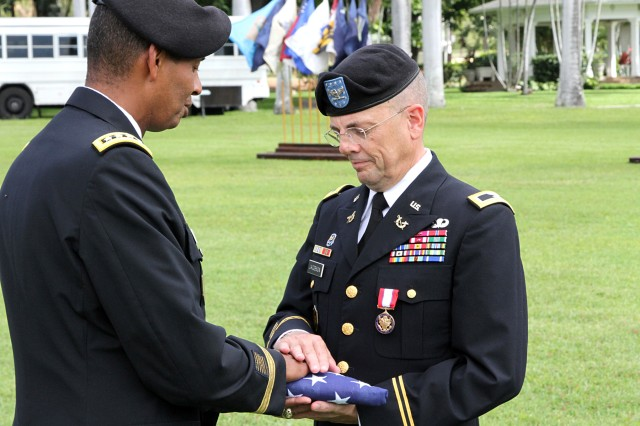 Col. Jacobson receives retirement flag a Celebration of Service